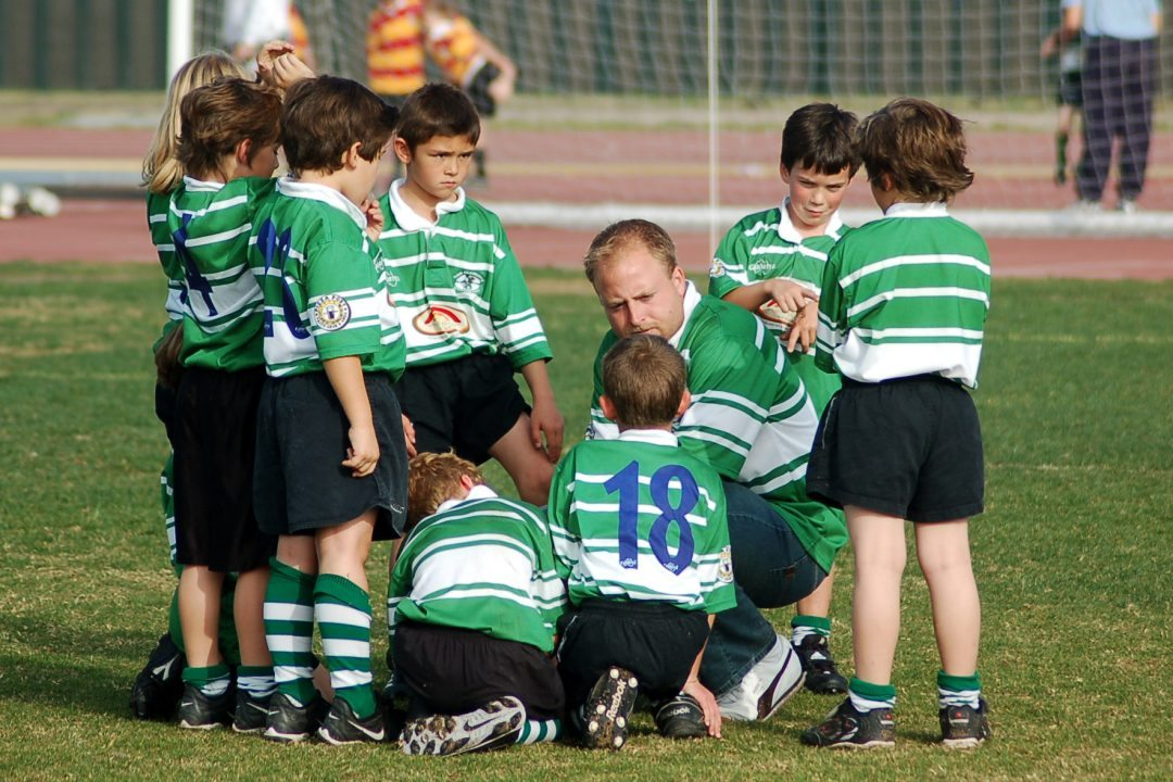 Coach_youth_huddle_7's_07