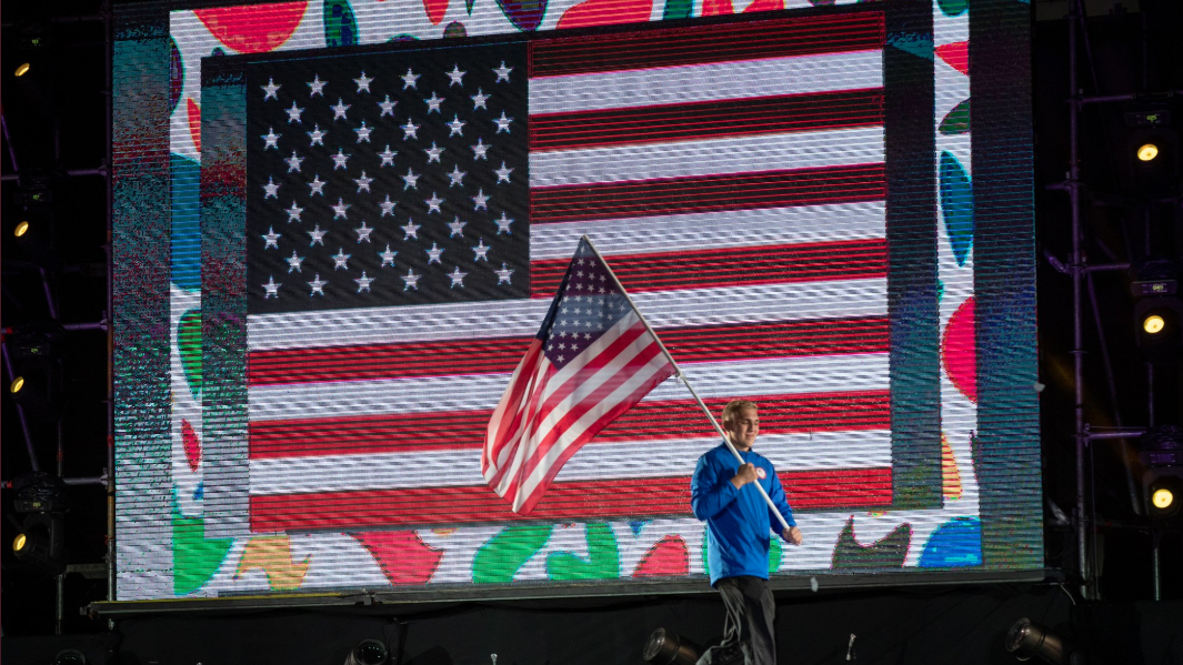 MHSAA Alex Cleary honored to carry flag during Youth Olympics Opening Ceremony
