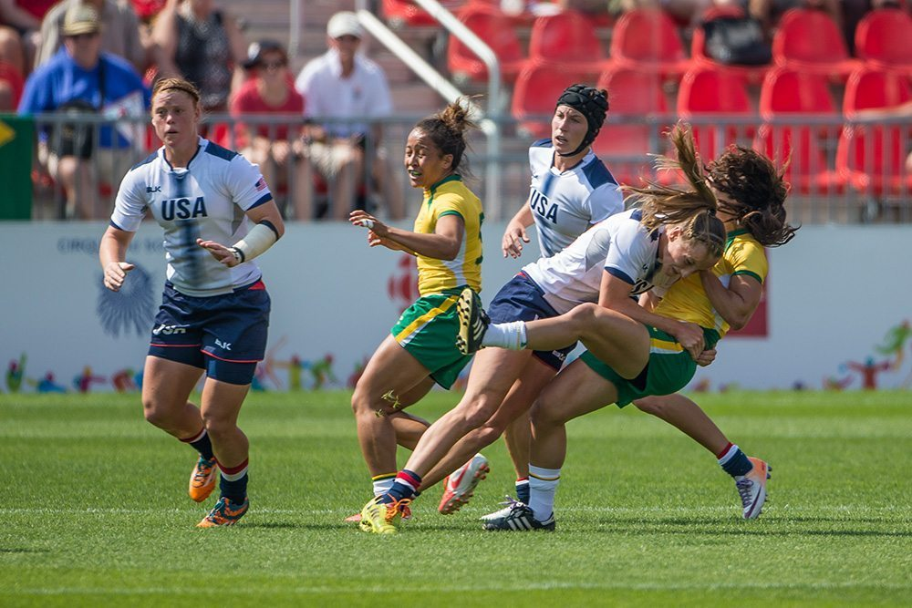 July 11, 2015, Toronto, Ontario, Canada; Kelly Griffin (#2( of the USA with a hard tackle during the USA vs Brazil in Women's Rugby during the Rugby Seven matches at the Toronto 2015 Pan Am Games. Final score of the game was USA 26 and Brazil 7. Photo Credit: Al Milligan - FotoJump